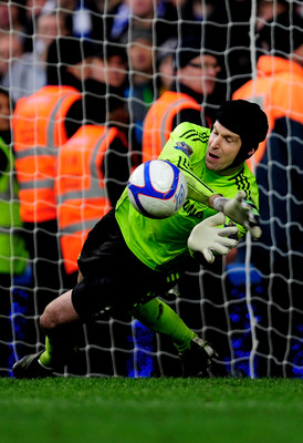 LONDON, ENGLAND - FEBRUARY 19:  Petr Cech of Chelsea saves the penalty of Leighton Baines of Everton in the penalty shootout during the FA Cup sponsored by E.ON 4th round replay match between Chelsea and Everton at Stamford Bridge on February 19, 2011 in
