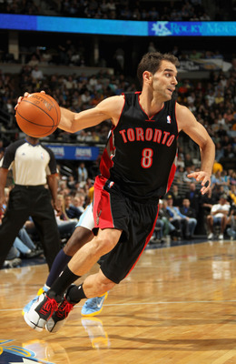 DENVER, CO - MARCH 21:  Jose Calderon #8 of the Toronto Raptors drives to the basket against the Denver Nuggets at the Pepsi Center on March 21, 2011 in Denver, Colorado. The Nuggets defeated the Raptors 123-90. NOTE TO USER: User expressly acknowledges a