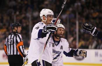 BOSTON, MA - MAY 17:  Vincent Lecavalier #4 celebrates with Martin St. Louis #26 of the Tampa Bay Lightning after Lecavalier scored a second period power play goal against the Boston Bruins in Game Two of the Eastern Conference Finals during the 2011 NHL