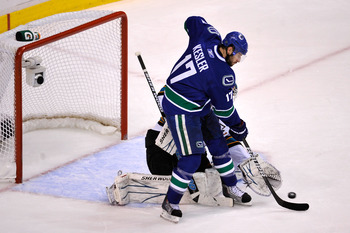 VANCOUVER, BC - MAY 15:  Ryan Kesler #17 of the Vancouver Canucks tries to deflect the puck in front of goaltender Antti Niemi #31 of the San Jose Sharks in Game One of the Western Conference Finals during the 2011 Stanley Cup Playoffs at Rogers Arena on