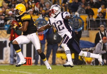 PITTSBURGH, PA - NOVEMBER 14:  Mike Wallace #17 of the Pittsburgh Steelers attempts to run from Devin McCourty #32 of the New England Patriots during the game on November 14, 2010 at Heinz Field in Pittsburgh, Pennsylvania.  (Photo by Jared Wickerham/Gett