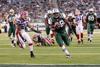EAST RUTHERFORD, NJ - JANUARY 02:  John Conner #38 of the New York Jets runs for a touchdown against the defense of Donte Whitner #20 of the Buffalo Bills at New Meadowlands Stadium on January 2, 2011 in East Rutherford, New Jersey.  (Photo by Al Bello/Ge
