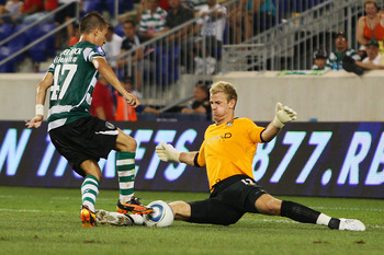 HARRISON, NJ - JULY 23:  Goalkeeper Joe Hart #12 of Manchester City makes a save against Joao Pereira #47 of Sporting Lisbon in the Barclays New York Challenge July 23, 2010 at Red Bull Arena in Harrison, New Jersey. Sporting Lisbon won 2-0.  (Photo by Mi