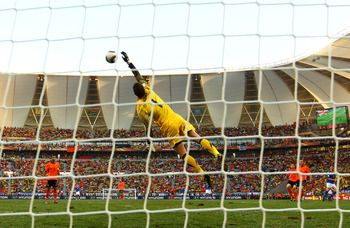 PORT ELIZABETH, SOUTH AFRICA - JULY 02: Maarten Stekelenburg of the Netherlands makes a diving save from a Kaka shot during the 2010 FIFA World Cup South Africa Quarter Final match between Netherlands and Brazil at Nelson Mandela Bay Stadium on July 2, 20