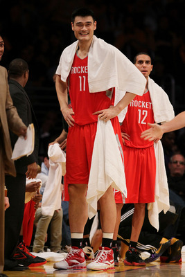 LOS ANGELES, CA - OCTOBER 26:  Yao Ming #11 of the Houston Rockets stands by the bench during their opening night game against the Los Angeles Lakers at Staples Center on October 26, 2010 in Los Angeles, California. NOTE TO USER: User expressly acknowledg