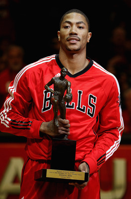 CHICAGO, IL - MAY 04: Derrick Rose #1 of the Chicago Bulls holds the Maurice Podoloff Trophy awarded to the NBA Most Valuable Player before taking on the Atlanta Hawks in Game Two of the Eastern Conference Semifinals in the 2011 NBA Playoffs at the United