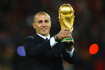 JOHANNESBURG, SOUTH AFRICA - JULY 11:  Fabio Cannavaro of Italy presents the World Cup trophy prior to the 2010 FIFA World Cup South Africa Final match between Netherlands and Spain at Soccer City Stadium on July 11, 2010 in Johannesburg, South Africa.  (