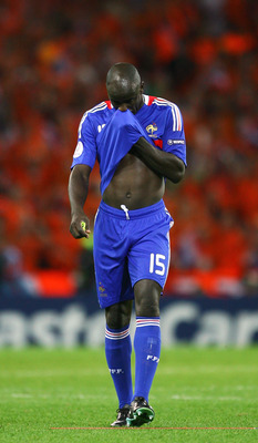 BERNE, SWITZERLAND - JUNE 13: Lilian Thuram of France looks dejected after defeat in the UEFA EURO 2008 Group C match between Netherlands and France at Stade de Suisse Wankdorf on June 13, 2008 in Berne, Switzerland.  (Photo by Bryn Lennon/Getty Images)