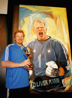 SANDTON, SOUTH AFRICA - JUNE 25:  Oliver Kahn poses in front of a portrait of himself to be auctioned, during the adidas Penalty Day at the Jo'bulani Centre on June 25, 2010 in Sandton, South Africa.  (Photo by Dominic Barnardt/Getty Images for adidas)