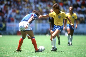 JUN 1986:  ZICO OF BRAZIL TAKES ON AN UNIDENTIFIED FRENCH DEFENDER DURING THE 1986 WORLD CUP IN MEXICO.  BRAZIL BEAT FRANCE 5-4. Mandatory Credit: David Cannon/ALLSPORT