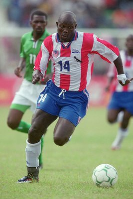 5 May 2001:  George Weah of Liberia runs with the ball during the World Cup 2002 Group B Second Round Qualifying match against Nigeria played at Port Harcourt, in Nigeria. Nigeria won the match 2-0. \ Mandatory Credit: Ben Radford /Allsport