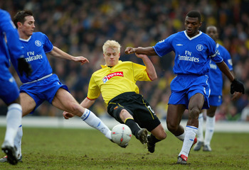 WATFORD, ENGLAND - JANUARY 3:  Frank Lampard and Marcel Desaily of Chelsea tries to tackle Heidar Helguson of Watford during the FA Cup Third Round match between Watford and Chelsea at Vicarage Road on January 3, 2004 in Watford, England. (Photo by Ben Ra