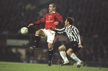20 Nov 1996: Eric Cantona of United (left) gets to the ball ahead of Ciro Ferrara of Juventus during the champions league match between Manchester United and Juventus at Old Trafford, Manchester. Juventus won 0-1. Mandatory Credit: Graham Chadwick/Allspor