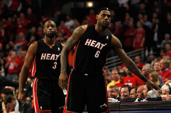 CHICAGO, IL - MAY 15:  (L-R) Dwyane Wade #3 and LeBron James #6 of the Miami Heat check in at the scorer's table priot to the opening tip-off against the Chicago Bulls in Game One of the Eastern Conference Finals during the 2011 NBA Playoffs on May 15, 20
