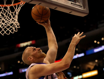 LOS ANGELES - NOVEMBER 3: Chris Kaman #35 of the Los Angeles Clippers shoots against the Oklahoma City Thunder at Staples Center on November 3, 2010 in Los Angeles, California. The Clippers won 107-92.  NOTE TO USER: User expressly acknowledges and agrees