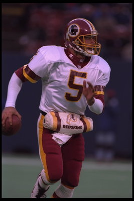 10 Dec 1995:  Quarterback Heath Schuler #5 of the Washington Redskins drops back to pass downfield to a receiver during the game against the New York Giants at Giants Stadium in East Rutherford, New Jersey.  The Giants defeated the Redskins 20-13.  Mandat