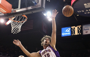 PHOENIX, AZ - FEBRUARY 10:  Robin Lopez #15 of the Phoenix Suns looses the ball as he attempts a shot during the NBA game against the Golden State Warriors at US Airways Center on February 10, 2011 in Phoenix, Arizona.  The Suns defeated the Warriors 112-
