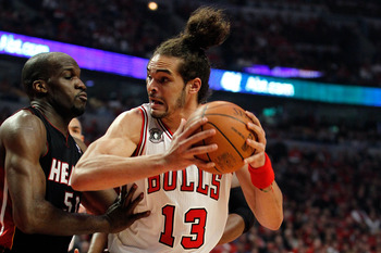 CHICAGO, IL - MAY 15:  Joakim Noah #13 of the Chicago Bulls moves the ball in the post against Joel Anthony #50 of the Miami Heat in Game One of the Eastern Conference Finals during the 2011 NBA Playoffs on May 15, 2011 at the United Center in Chicago, Il
