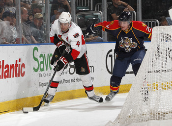 SUNRISE, FL - MARCH 31: Chris Phillips #4 of the Ottawa Senators clears the puck from Ryan Carter #20 of the Florida Panthers on March 31, 2011 at the BankAtlantic Center in Sunrise, Florida. The Senators defeated the Panthers 4-1. (Photo by Joel Auerbach