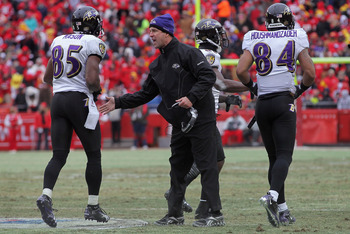 KANSAS CITY, MO - JANUARY 09: Head coach John Harbaugh of the Baltimore Ravens welcomes wide receivers Derrick Mason #85 and T.J. Houshmandzadeh back to the bench during their 2011 AFC wild card playoff game against the Kansas City Chiefs at Arrowhead Sta