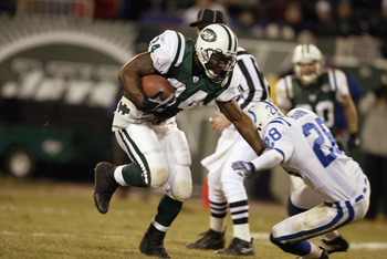 EAST RUTHERFORD, NJ - JANUARY 4:  LaMont Jordan #34 of the New York Jets runs past Idrees Bashir #28 of the Indianapolis Colts during the AFC wildcard game at Giants Stadium on January 4, 2003 in East Rutherford, New Jersey.  The Jets won 41-0.  (Photo by