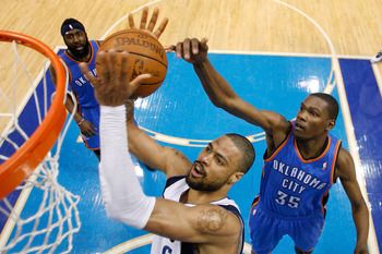 DALLAS, TX - MAY 19:  Tyson Chandler #6 of the Dallas Mavericks grabs the ball in front of Kevin Durant #35 of the Oklahoma City Thunder in the second half in Game Two of the Western Conference Finals during the 2011 NBA Playoffs at American Airlines Cent