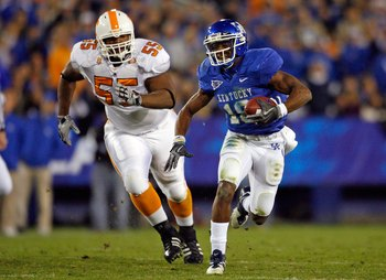 LEXINGTON, KY - NOVEMBER 28:  Randall Cobb #18 of the Kentucky Wildcats runs with the ball while defended by Dan Williams #55 of the Tennessee Volunteers during the SEC game at Commonwealth Stadium on November 28, 2009 in Lexington, Kentucky.  (Photo by A
