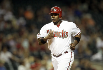 PHOENIX, AZ - MAY 17:  Justin Upton #10 of the Arizona Diamondbacks comes in to score a run against the San Diego Padres during the seventh inning of the Major League Baseball game at Chase Field on May 17, 2011 in Phoenix, Arizona.  (Photo by Christian P