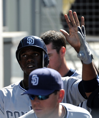 LOS ANGELES, CA - MAY 01:  Cameron Maybin #24 of the San Diego Padres celebrates his run in the dugout for a 4-0 lead over the Los Angeles Dodgers at Dodger Stadium on May 1, 2011 in Los Angeles, California.  (Photo by Harry How/Getty Images)