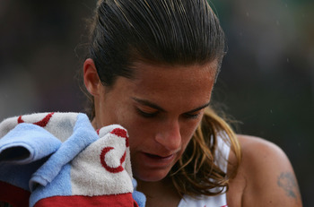 PARIS - JUNE 1:  Amelie Mauresmo of France after losing her quarterfinal match against Elena Dementieva of Russia during Day Nine of the 2004 French Open Tennis Championship at Roland Garros June 1, 2004 in Paris, France. (Photo by Clive Brunskill/Getty I