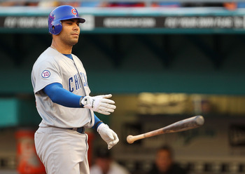 MIAMI GARDENS, FL - MAY 18:  Carlos Pena #22 of the Chicago Cubs draws a walk during a game against the Florida Marlins at Sun Life Stadium on May 18, 2011 in Miami Gardens, Florida.  (Photo by Mike Ehrmann/Getty Images)