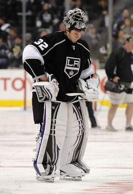 LOS ANGELES, CA - APRIL 25:  Jonathan Quick #32 of the Los Angeles Kings skates off the ice after being eliminated in game six of the Western Conference Quarterfinals by the San Jose Sharks during the 2011 NHL Stanley Cup Playoffs at Staples Center on Apr