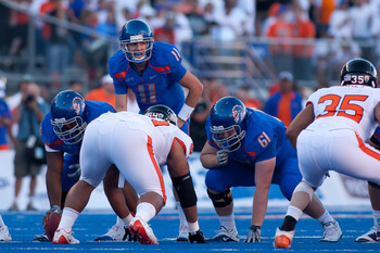 BOISE, ID - SEPTEMBER 25:  Quarterback Kellen Moore #11 of the Boise State Broncos calls a play against the Oregon State Beavers at Bronco Stadium on September 25, 2010 in Boise, Idaho.  (Photo by Otto Kitsinger III/Getty Images)