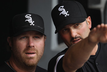 CHICAGO, IL - APRIL 07: Paul Konerko #14 of the Chicago White Sox (R) talks about the stadium to teammate Adam Dunn #32 before the home opener against the Tampa Bay Rays at U.S. Cellular Field on April 7, 2011 in Chicago, Illinois. (Photo by Jonathan Dani