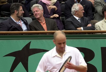 6 Jun 2001:  Bill Clinton watches Andre Agassi of the USA  in his Quarter final match against Sebastien Grosjean of France during the French Open Tennis at Roland Garros, Paris, France....DIGITAL IMAGE. Mandatory Credit: Clive Brunskill/ALLSPORT
