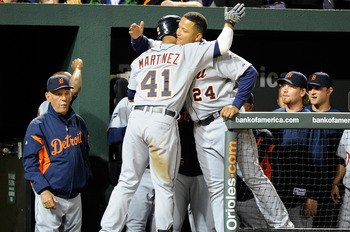 BALTIMORE, MD - APRIL 06:  Victor Martinez #41 and Miguel Cabrera #24 of the Detroit Tigers celebrate after hitting back to back home runs in the fifth inning against the Baltimore Orioles at Oriole Park at Camden Yards on April 6, 2011 in Baltimore, Mary