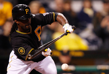 PITTSBURGH - MAY 06:  Andrew McCutchen #22 of the Pittsburgh Pirates lays down a bunt against the Houston Astros during the game on May 6, 2011 at PNC Park in Pittsburgh, Pennsylvania.  (Photo by Jared Wickerham/Getty Images)