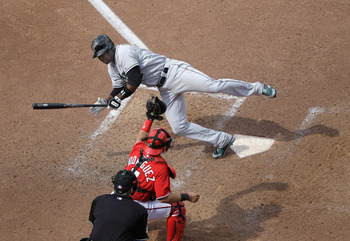 WASHINGTON, DC - MAY 15: Hanley Ramirez #2 of the Florida Marlins is brushed back by a pitch during the seventh inning as catcher Ivan Rodriguez #7 of the Washington Nationals holds onto the ball at Nationals Park on May 15, 2011 in Washington, DC.  (Phot