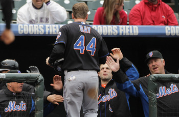 DENVER, CO - MAY 12:  Jason Bay #44 of the New York Mets is welcomed back to the dugout after scoring on a sacrifice fly by Josh Thole of the Mets to give the Mets a 3-1 lead over the Colorado Rockies in the fourth inning at Coors Field on May 12, 2011 in