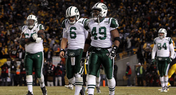 PITTSBURGH, PA - JANUARY 23:  Tony Richardson #49 and Mark Sanchez #6 of the New York Jets walk towards the sideline late in the fourth quarter against the Pittsburgh Steelers during the 2011 AFC Championship game at Heinz Field on January 23, 2011 in Pit