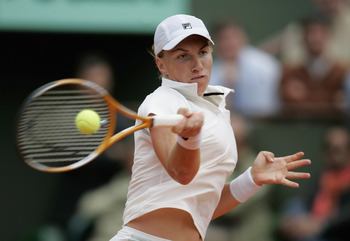 PARIS - MAY 30:  Svetlana Kuznetsova of Russia in action during her fourth round match against Justine Henin-Hardenne of Belgium during the eighth day of the French Open at Roland Garros on May 30, 2005 in Paris, France.  (Photo by Clive Mason/Getty Image