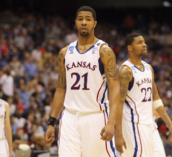 SAN ANTONIO, TX - MARCH 27:  Markieff Morris #21 and Marcus Morris #22 of the Kansas Jayhawks react during the southwest regional final of the 2011 NCAA men's basketball tournament against the Virginia Commonwealth Rams at the Alamodome on March 27, 2011