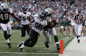 EAST RUTHERFORD, NJ - NOVEMBER 15:  Shonn Greene #23 of the New York Jets runs the ball against Justin Durant #56 of the Jacksonville Jaguars on November 15, 2009 at Giants Stadium in East Rutherford, New Jersey. Jacksonville defeated the Jets 24-22.  (Ph