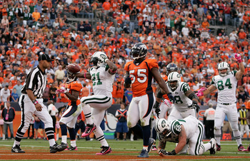 DENVER - OCTOBER 17:  Running back LaDainian Tomlinson #21 of the New York Jets celebrates his touchdown against the Denver Broncos at INVESCO Field at Mile High on October 17, 2010 in Denver, Colorado. The Jets defeated the Broncos 24-20. (Photo by Justi