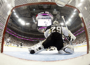 PITTSBURGH, PA - APRIL 27:  Marc-Andre Fleury #29 of the Pittsburgh Penguins protects the net against the Tampa Bay Lightning in Game Seven of the Eastern Conference Quarterfinals during the 2011 NHL Stanley Cup Playoffs at Consol Energy Center on April 2