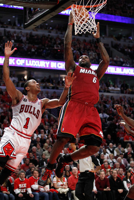CHICAGO, IL - MAY 18:  LeBron James #6 of the Miami Heat drives for a shot attempt against Derrick Rose #1 of the Chicago Bulls in Game Two of the Eastern Conference Finals during the 2011 NBA Playoffs on May 18, 2011 at the United Center in Chicago, Illi