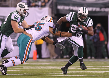 EAST RUTHERFORD, NJ - DECEMBER 12: Shonn Greene #23 of the New York Jets rushes against the Miami Dolphins at New Meadowlands Stadium on December 12, 2010 in East Rutherford, New Jersey.  (Photo by Nick Laham/Getty Images)