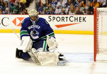 VANCOUVER, CANADA - MAY 18: Goaltender Roberto Luongo #1 of the Vancouver Canucks makes a save in the first period in Game Two of the Western Conference Finals against the San Jose Sharks  during the 2011 Stanley Cup Playoffs at Rogers Arena on May 18, 20