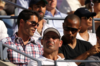 NEW YORK - SEPTEMBER 08:  French Soccer Player Thierry Henry (R) attends day ten of the 2010 U.S. Open at the USTA Billie Jean King National Tennis Center on September 8, 2010 in the Flushing neighborhood of the Queens borough of New York City.  (Photo by