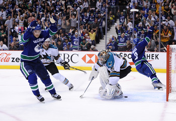 VANCOUVER, CANADA - MAY 18:  Mason Raymond #21 and Kevin Bieksa #3 of the Vancouver Canucks react Bieksa scored a goal against Antti Niemi #31 of the San Jose Sharks in the second period in Game Two of the Western Conference Finals during the 2011 Stanley